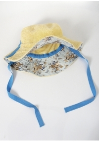 Terry cloth hat with a brim in pale yellow