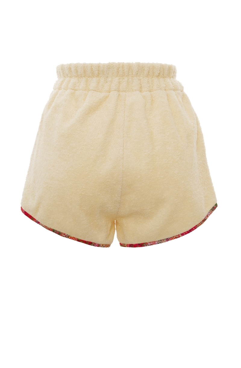Terry cloth shorts with a retro cut in peach