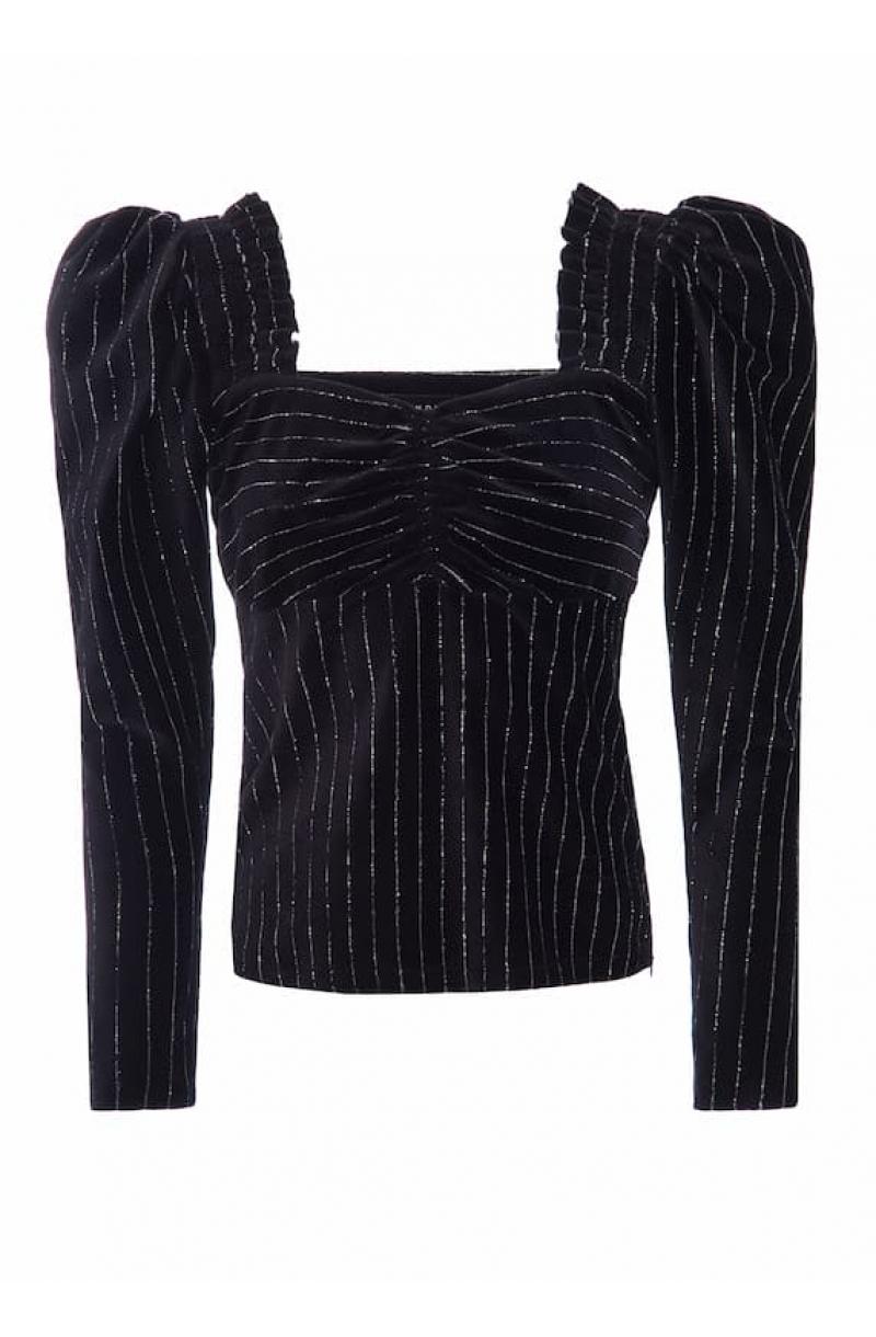 Blusa de velludo negro con mangas abullonadas